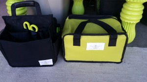 Under the cutting table -- my travel fitting bag and my sizing leotards bag.