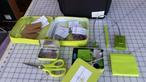 The traveling fitting bag, exploded...includes samples of rhinestones and everything I need for a remote fitting. Obsessively weird about that chartreuse green thing, I know...but once I started I just couldn't stop!