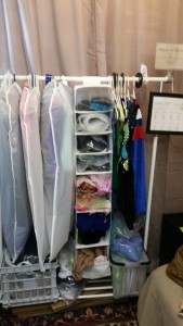 Works in progress. For some reason this also looks really small, but each garment bag holds TEN dresses for sale, packaged up for travel. Each compartment in the hanging shelves holds an outfit in progress.