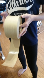 Tape is easy to cut when your model holds the roll.